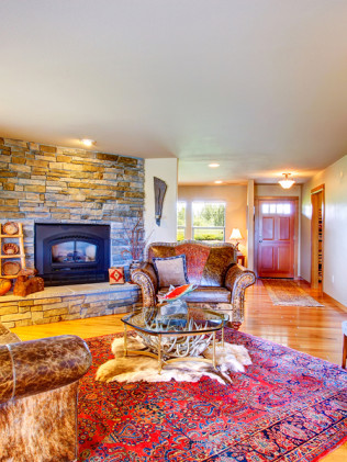 Living Room with Cozy Stone Fireplace Surround