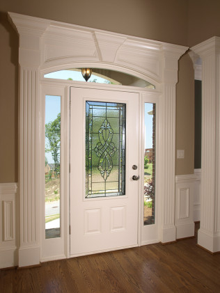 White Front Door with Ornate Decorative Glass Insert