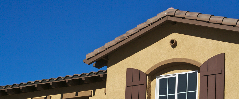 Tan Stucco Home with New Windows