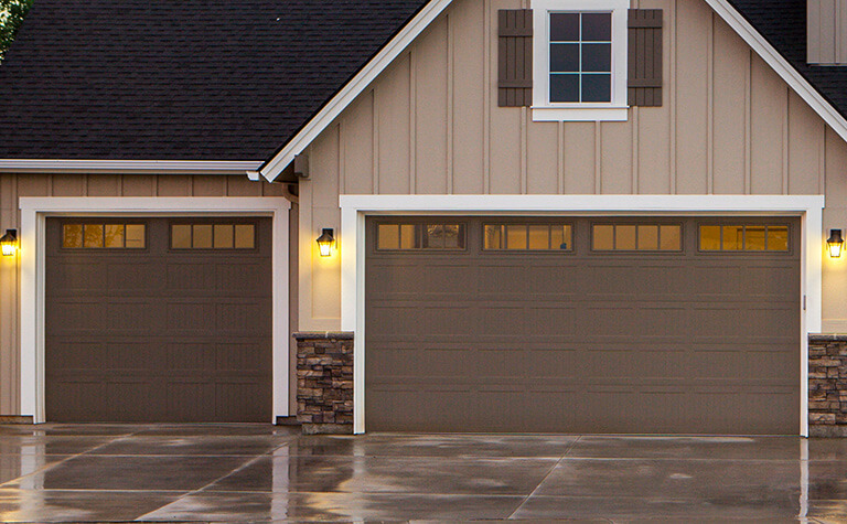 Brown Garage Doors with Windows on Home
